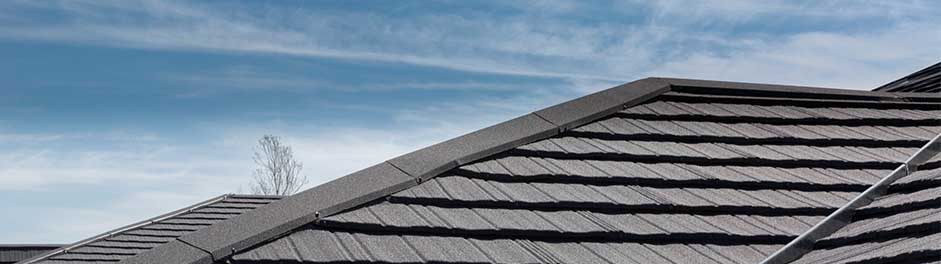 Bryn Bach Park Visitor Centre with Charcoal Metrotile Lightweight Roofing Slate .900 extra secure solution