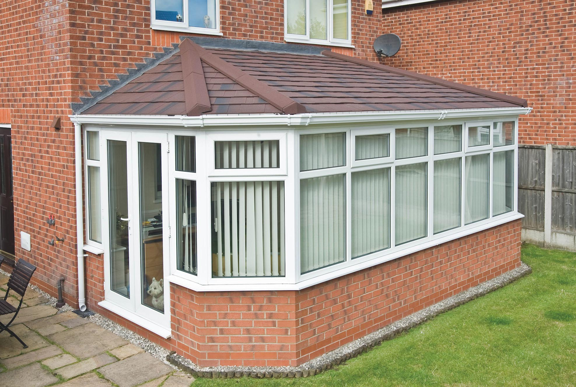 Conservatory refurbished with a Metrotile Lightweight Roof System Shingle Antique Red