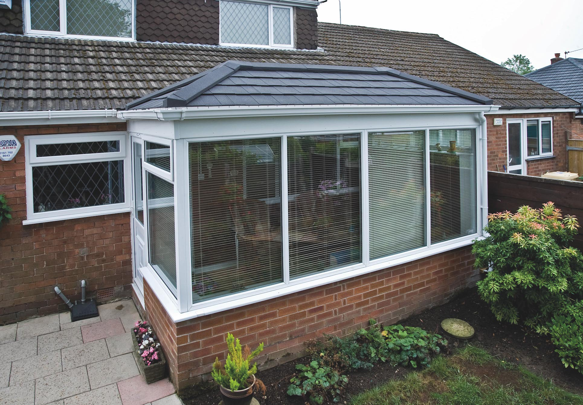 Conservatory refurbished with a Metrotile Lightweight Roof System Shingle Charcoal