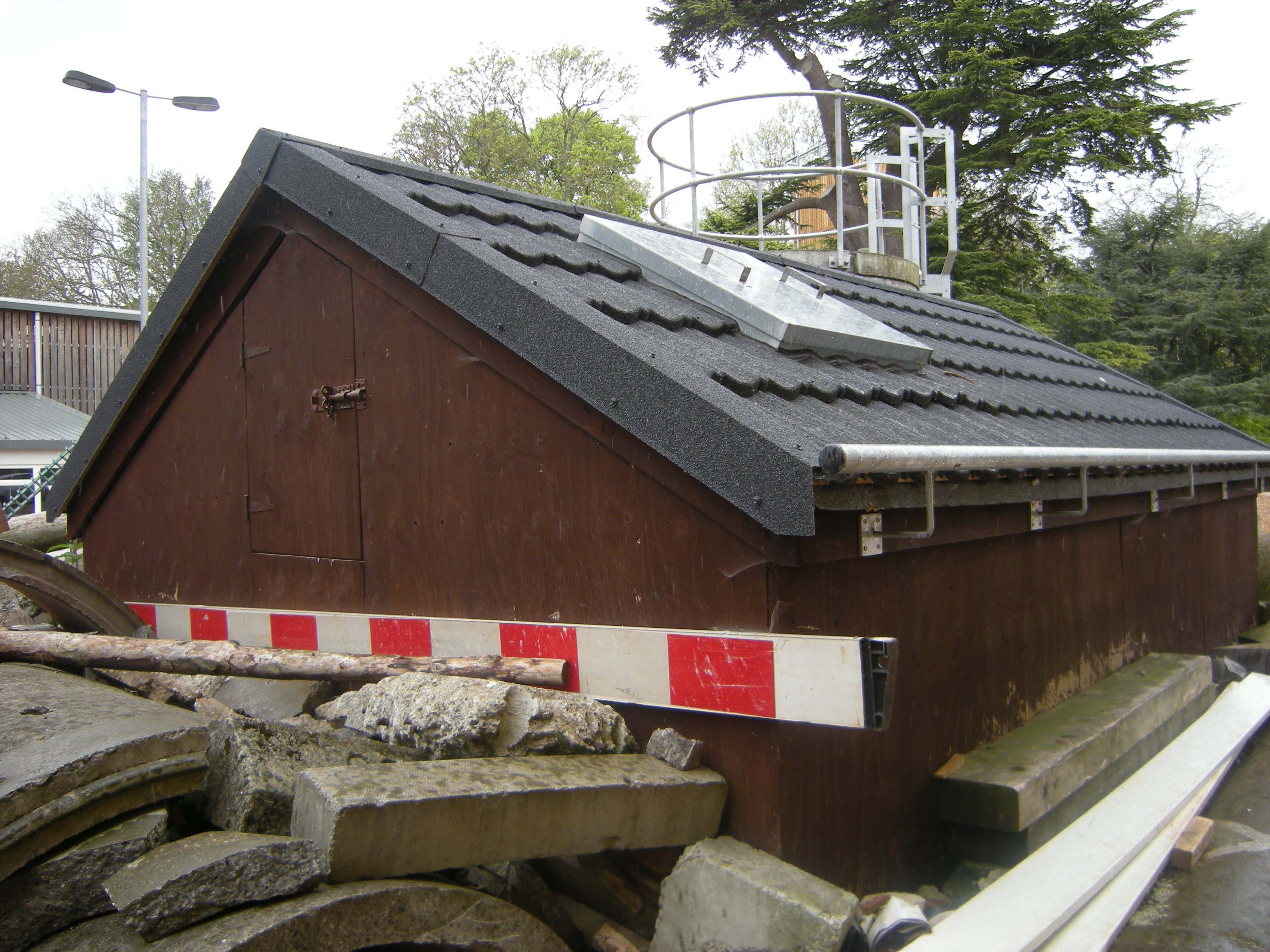 Fire station training roof lightweight steel roofing metrotile bond charcoal