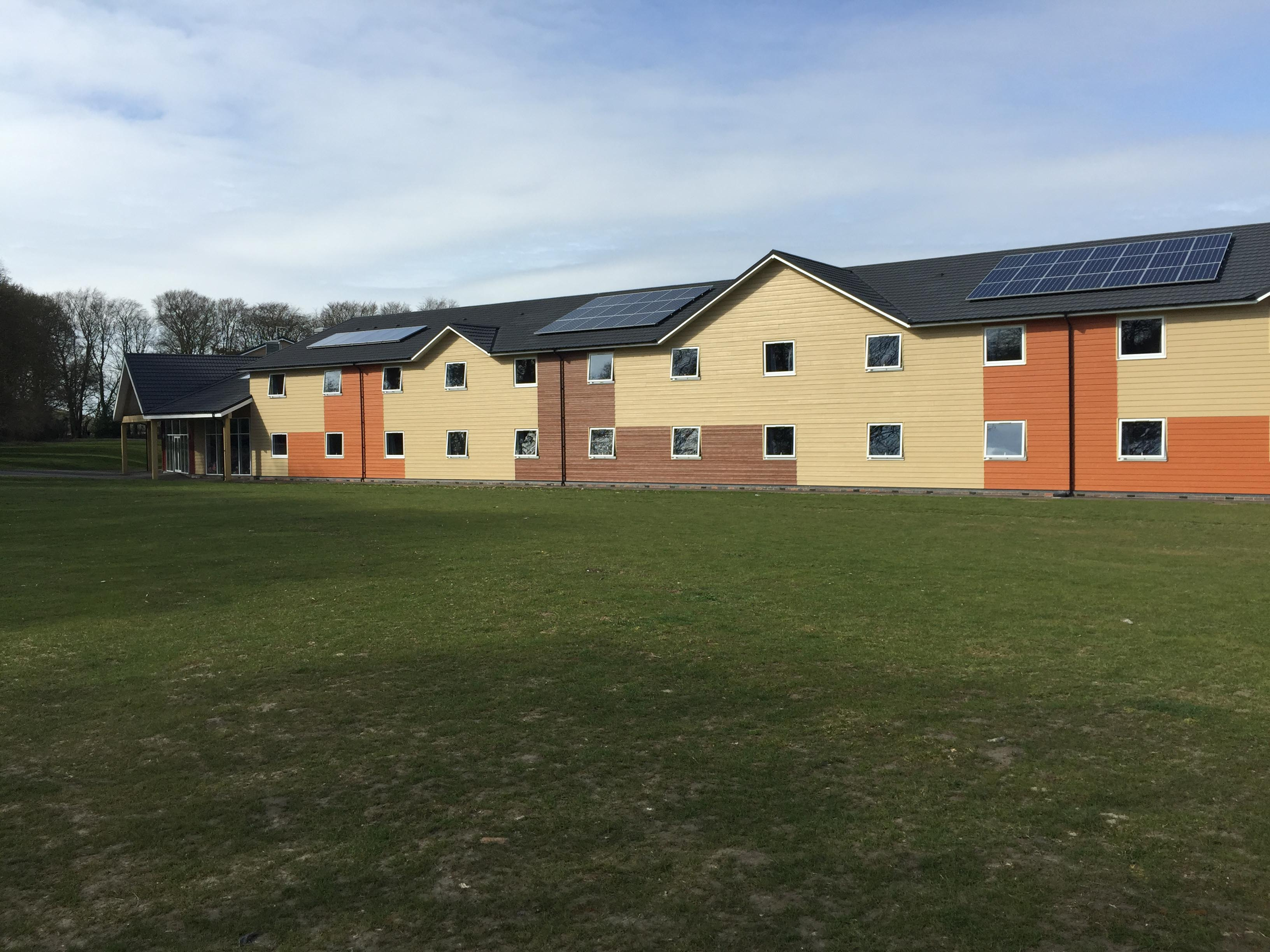 PGL Liddington Timber Frame Accommodation with Metrotile Lightweight Roofing in Bond Charcoal with retrofit Photovoltaic System