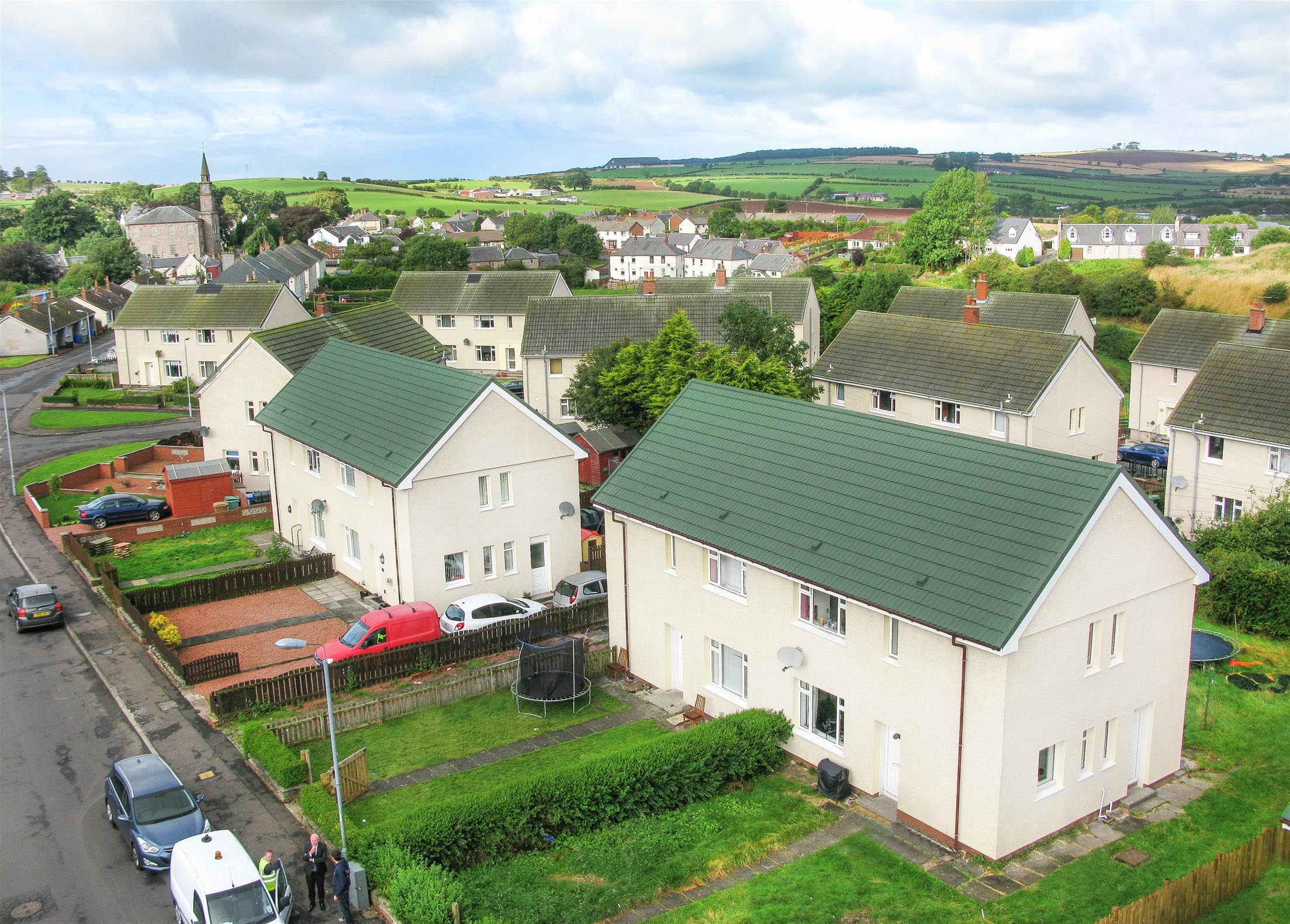 Local Authority Homes in Glasgow with Metrotile Lightweight Roofing Bond Green